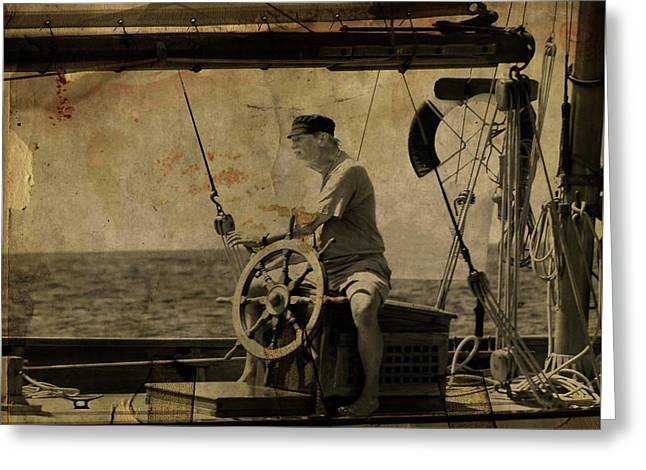 Greeting Card featuring the photograph old sailor A vintage processed photo of a sailor sitted behind the rudder in Mediterranean sailing by Pedro Cardona