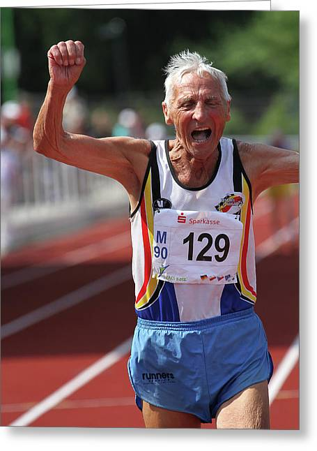 Older Athlete Triumphs Greeting Card by Alex Rotas