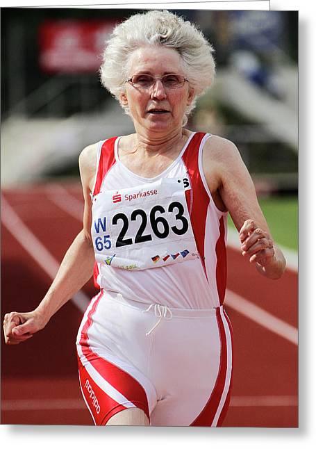 Older Female Athlete Runs To Camera Greeting Card