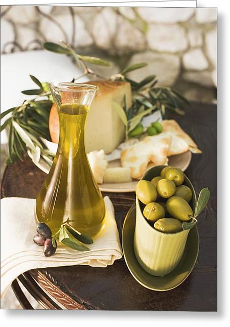 Olives, Olive Oil, Cheese And Crackers On Table Out Of Doors Greeting Card