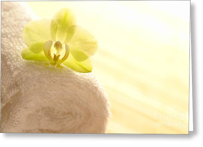 Orchid On Towel Greeting Card by Olivier Le Queinec