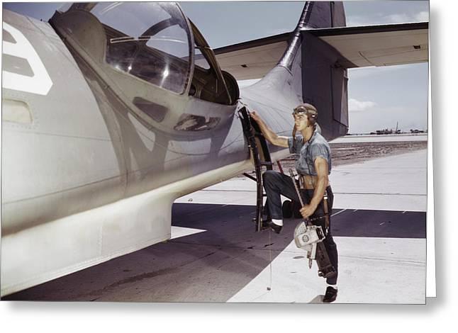 Ordnanceman Climbs A Pby Catalina Navy Greeting Card by Stocktrek Images