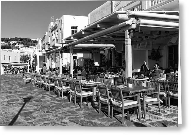 Outdoor Cafe In Mykonos Town Mono Greeting Card by John Rizzuto