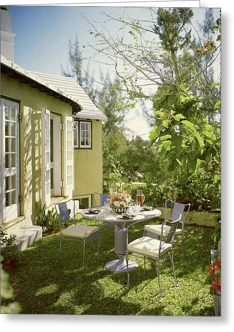 Outdoor Furniture At Shoreland House Greeting Card by Tom Leonard