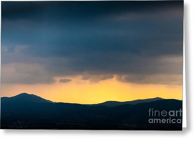 Overcast Dark Sky Rain Clouds With Yellow Glow Beyond Hills On H Greeting Card