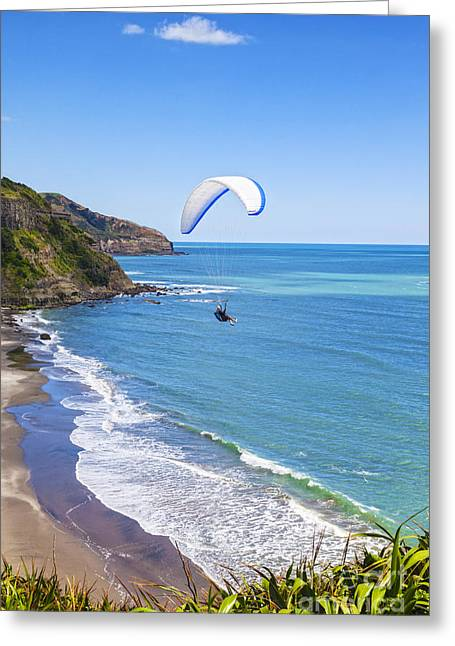 Paragliding At Maori Bay Auckland Greeting Card by Colin and Linda McKie