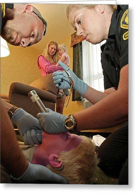 Paramedics Work To Save Choking Boy Greeting Card by Kevin Link