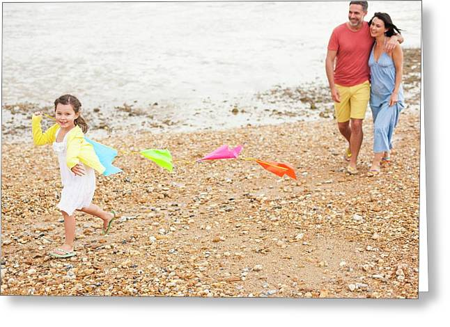 Parents On Beach With Daughter Greeting Card