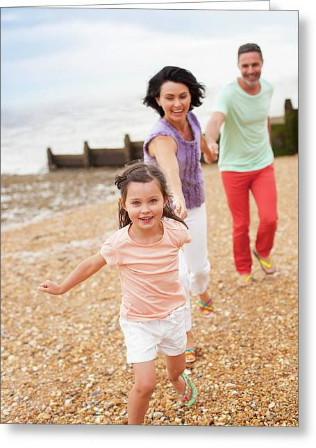 Parents Running On Beach With Daughter Greeting Card