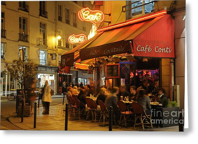 Paris Street Cafe At Night Greeting Card by Colin Woods