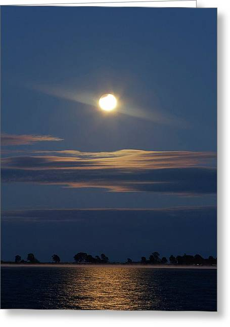 Partial Lunar Eclipse Over Coastal Lagoon Greeting Card by Luis Argerich