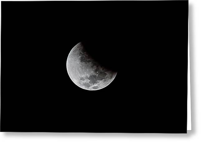 Partial Phase Of A Total Lunar Eclipse Greeting Card by Babak Tafreshi