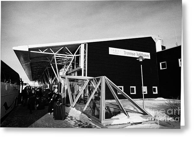 passengers with luggage get off coach at Tromso airport troms Norway Greeting Card by Joe Fox