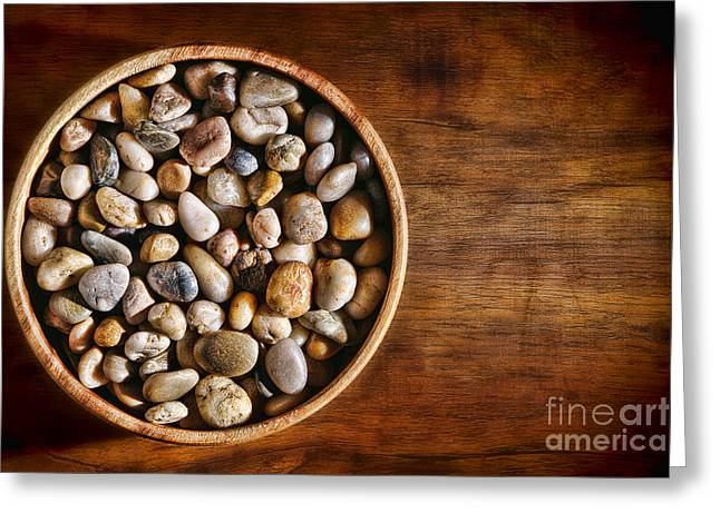 Pebbles In Wood Bowl Greeting Card by Olivier Le Queinec