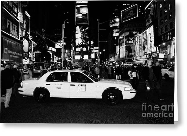 Pedestrians Walk Past Yellow Cab Stationary In The Middle Of Times Square At Night New York City Greeting Card