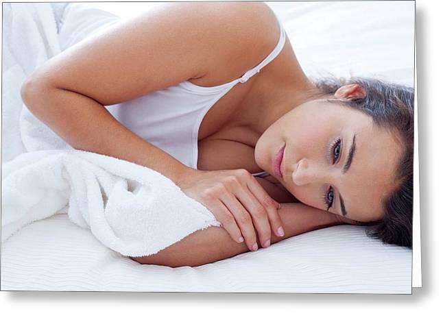Pensive Woman Lying Awake In Bed Greeting Card by Ian Hooton
