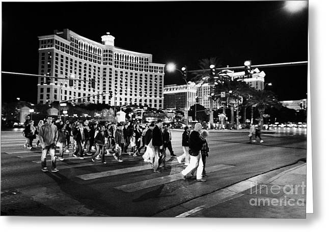 People Crossing Las Vegas Boulevard Outside The Bellagio At Night Nevada Usa Greeting Card by Joe Fox