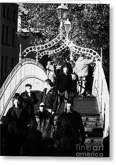 People Crossing The Hapenny Ha Penny Bridge Over The River Liffey In Dublin At A Busy Time Vertical Greeting Card by Joe Fox