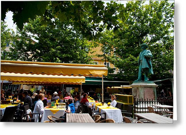 People In A Restaurant, Place Du Forum Greeting Card by Panoramic Images