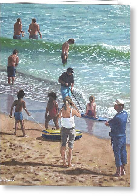 people on Bournemouth beach pulling dingys Greeting Card by Martin Davey