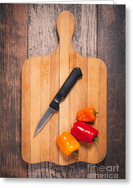 Peppers And Knife On Cutting Board Greeting Card by Sharon Dominick