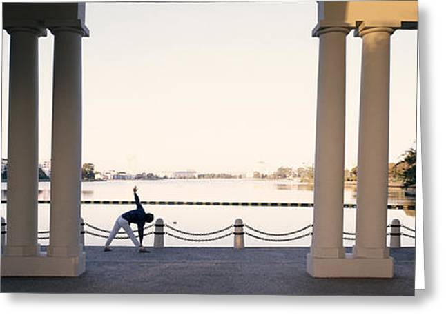 Person Stretching Near Colonnade, Lake Greeting Card