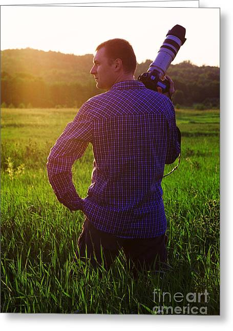 Photographer In Sunset Greeting Card by Aleksey Tugolukov