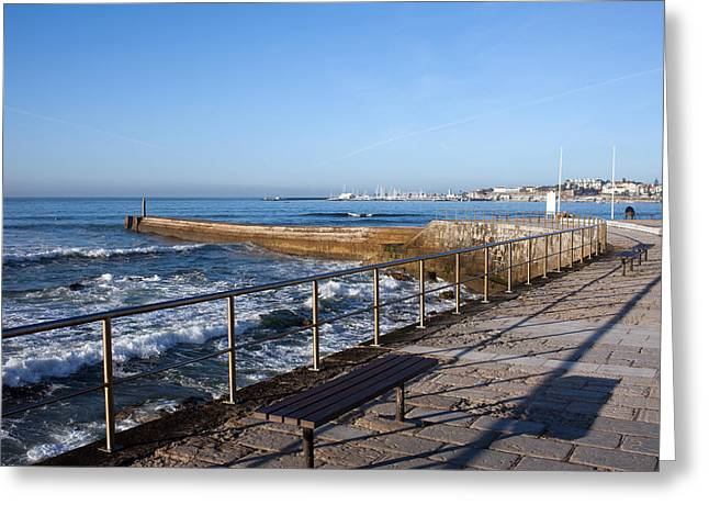 Pier And Promenade By The Atlantic Ocean In Cascais Greeting Card by Artur Bogacki