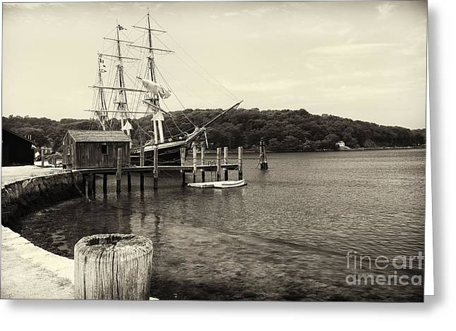 Pier With A Tall Ship Greeting Card by George Oze