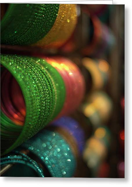 Piles Of Bangles Are Stacked Greeting Card by David H. Wells