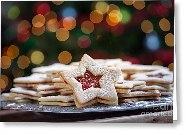 Plate Of Christmas Cookies Under Lights Greeting Card by Leslie Banks