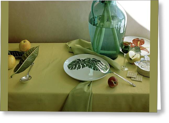 Plates, Apples And A Vase On A Green Tablecloth Greeting Card by Horst P. Horst