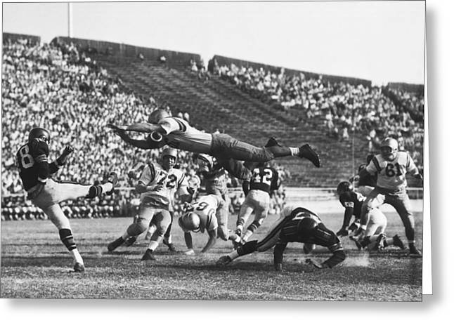 Player Blocks Football Punt Greeting Card by Underwood Archives