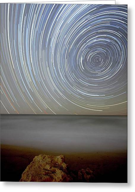 Polar Star Trails Over Coastal Waters Greeting Card