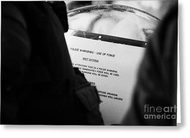 Police Baton Round  Riot Instructions On Inside Of Riot Shield On Crumlin Road At Ardoyne Shops Belf Greeting Card by Joe Fox