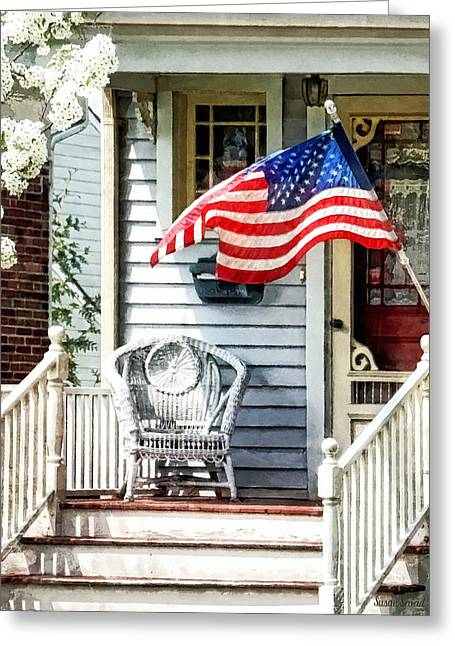 Porch With Flag And Wicker Chair Greeting Card by Susan Savad