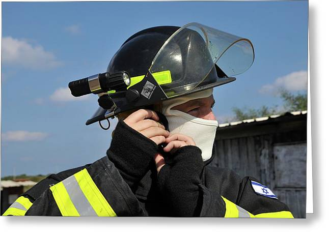 Portrait Of A Fire Fighte Greeting Card by Photostock-israel