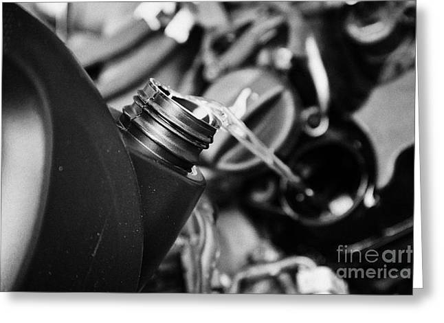 Pouring Fresh New Oil Into Engine Filler In A Car Engine Compartment Greeting Card by Joe Fox