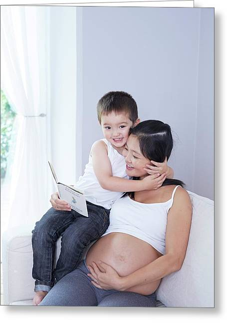 Pregnant Woman Reading To Son Greeting Card by Ruth Jenkinson