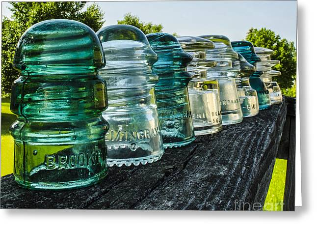 Pretty Glass Insulators All In A Row Greeting Card