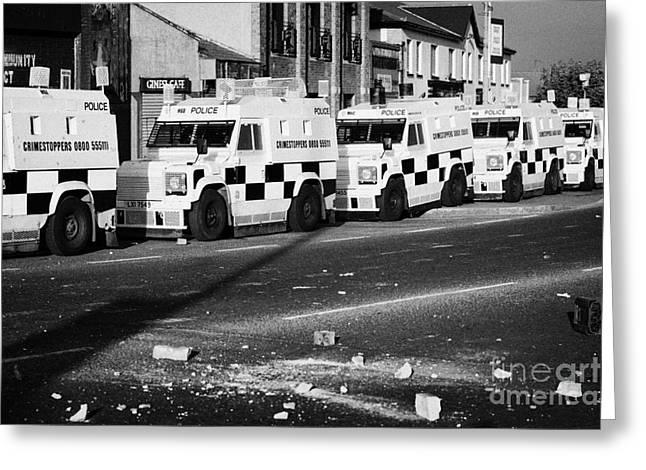Psni Armoured Land Rovers And Debris On Crumlin Road At Ardoyne Shops Belfast 12th July Greeting Card by Joe Fox