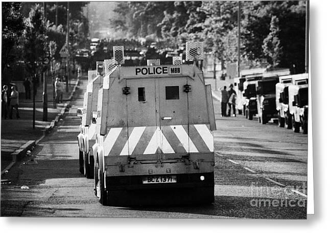 Psni Land Rovers Head Up The Crumlin Road Towards Loyalists At Ardoyne Shops Belfast 12th July Greeting Card by Joe Fox