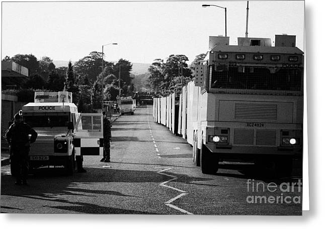 Psni Landrover And Watercannon In Wait In Preparation On Crumlin Road At Ardoyne Shops Belfast 12th  Greeting Card by Joe Fox