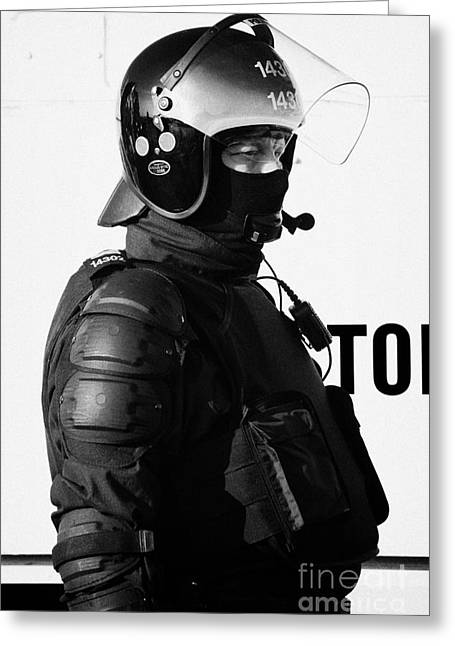 Psni Officer In Ninja Riot Geat On Crumlin Road At Ardoyne Shops Belfast 12th July Greeting Card by Joe Fox