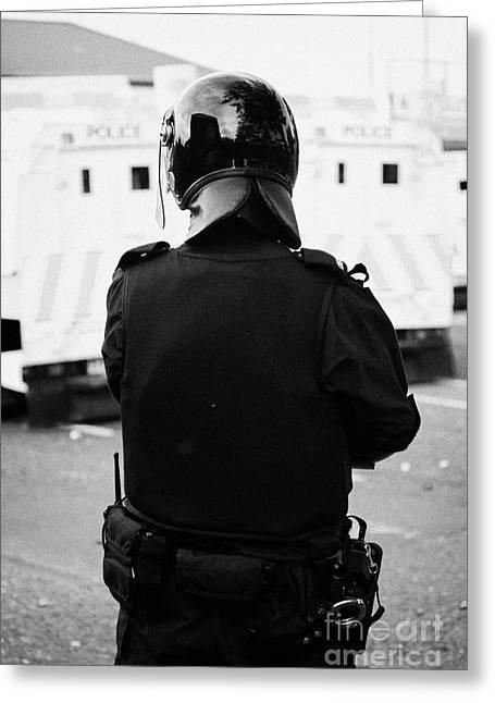 Psni Officer In Riot Gear On Crumlin Road At Ardoyne Shops Belfast 12th July Greeting Card by Joe Fox