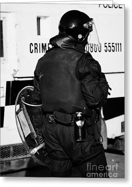 Psni Officer With Riot Gear On Crumlin Road At Ardoyne Shops Belfast 12th July Greeting Card by Joe Fox