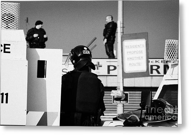 Psni Officers In Protective Riot Gear At Landrovers And Snipers On Crumlin Road At Ardoyne Shops Bel Greeting Card by Joe Fox