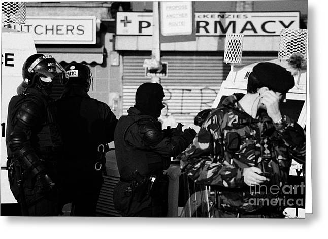 Psni Riot Officers And British Soldier On Crumlin Road At Ardoyne Shops Belfast 12th July Greeting Card by Joe Fox