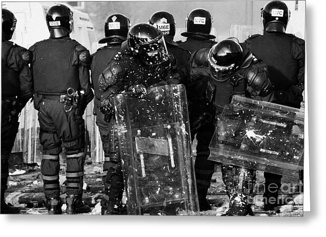 Psni Riot Officers Tend To Injured Colleague During Riot On Crumlin Road At Ardoyne Shops Belfast 12 Greeting Card by Joe Fox