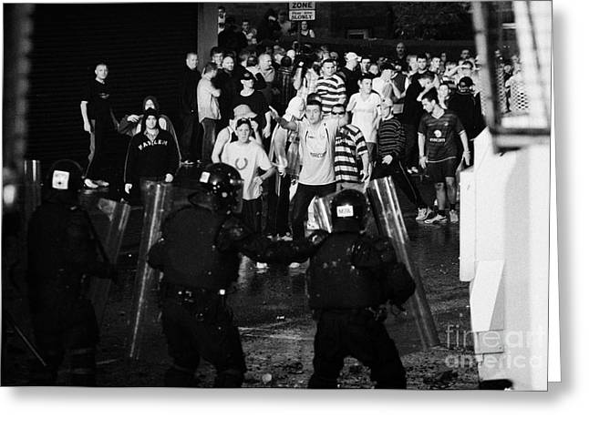 Psni Riot Police Face Angry Mob Of Rioters On Crumlin Road At Ardoyne Shops Belfast 12th July Greeting Card by Joe Fox